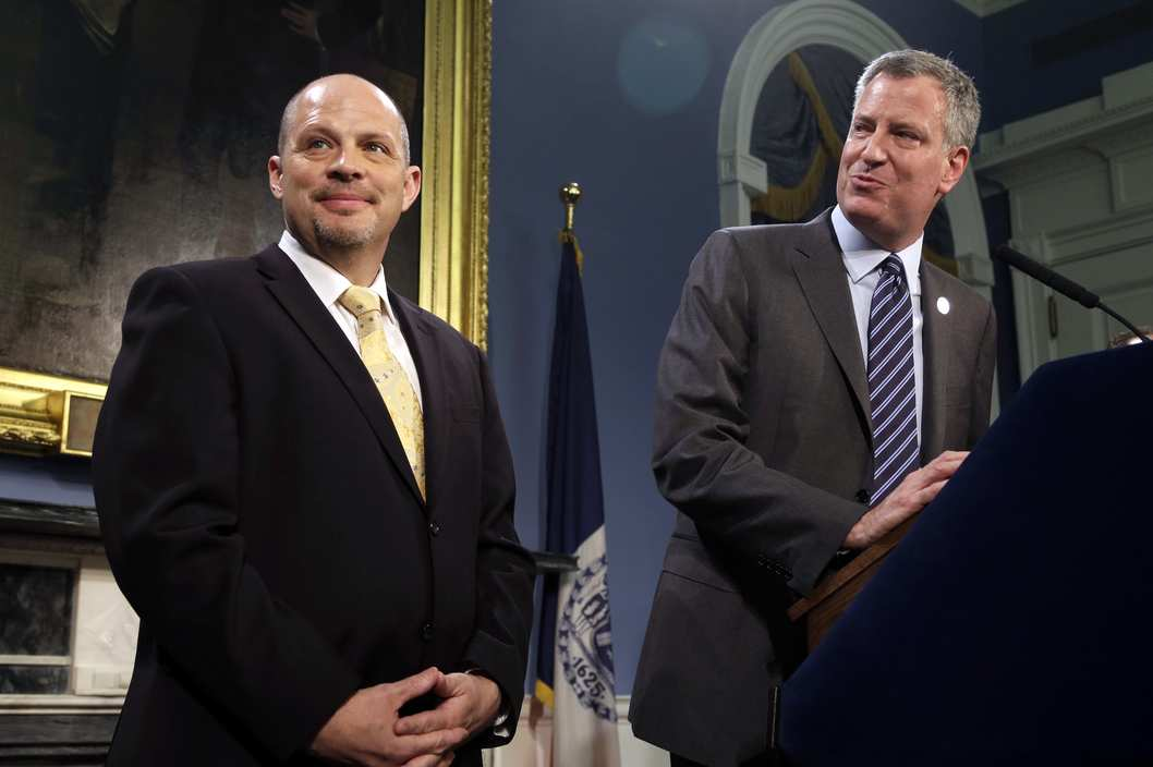 As New York City Mayor Bill de Blasio, right, and President of the United Federation of Teachers Michael Mulgrew participate in a news conference at City Hall in New York, Thursday, May 1, 2014. New York City and its largest teachers union struck a deal on a new contract Thursday, ending a nearly five-year labor dispute and potentially setting a template for negotiations with the city's other unions. (AP Photo/Seth Wenig)