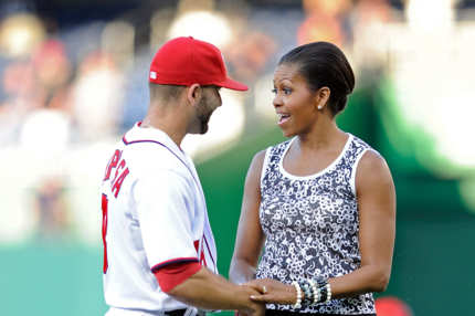 WASHINGTON, DC - JULY 05:  First Lady Michelle Obama shakes hands with Danny Espinosa #18 of the Washington Nationals before the game against the Chicago Cubs at Nationals Park on July 5, 2011 in Washington, DC.  (Photo by Greg Fiume/Getty Images)
