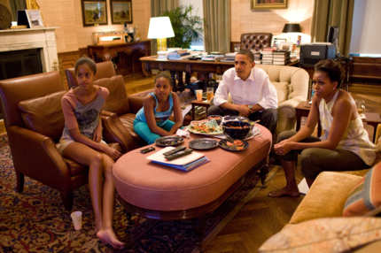 President Barack Obama and his daughters Sasha and Malia watch the World Cup soccer game between the U.S. and Japan, from the Treaty Room office in the residence of the White House, Sunday, July 17, 2011. (Official White House Photo by Pete Souza)