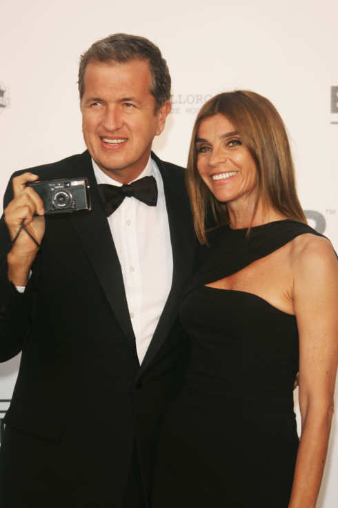 MOUGINS, FRANCE - MAY 23:  Photographer Mario Testino and French Vogue editor Carine Roitfeld arrive at the Cinema Against Aids 2007 in aid of amfAR at Le Moulin de Mougins in Mougings on May 23, 2007 in Cannes, France. The amfAR foundation raises funds for research, education and treatment of AIDS / HIV worldwide.  (Photo by Pascal Le Segretain/Getty Images)