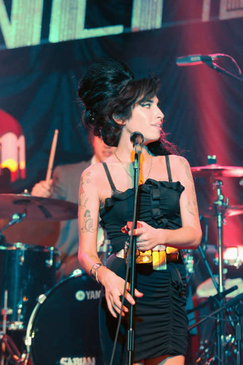 PARIS - FEBRUARY 29:  Amy Winehouse performs on stage at the Fendi Paris Store Reopening at Avenue Montaigne on February 29, 2008 in Paris, France.  (Photo by Dominique Charriau/WireImage)