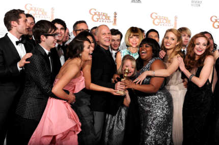 "BEVERLY HILLS, CA - JANUARY 16:  (L-R) Matthew Morrison, Kevin McHale, Lea Michele, Jenna Ushkowitz, Darren Criss, producer Ryan Murphy, Mark Salling, Chris Colfer, Lauren Potter, Amber Riley, Harry Shum Jr., Dianna Agron, Jayma Mays and cast/crew of ""Glee"" pose with the award for Best Television Series (Comedy or Musical) for ""Glee"" in the press room at the 68th Annual Golden Globe Awards held at The Beverly Hilton hotel on January 16, 2011 in Beverly Hills, California.  (Photo by Kevin Winter/Getty Images)"