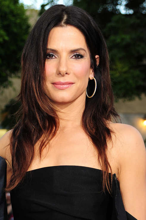 "Actress Sandra Bullock arrives at the world premiere of ""The Change-Up"" at the Village Theatre in Los Angeles, California on August 1, 2011.  AFP PHOTO / Robyn Beck (Photo credit should read ROBYN BECK/AFP/Getty Images)"