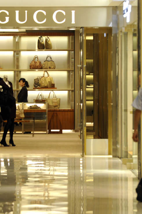 A saleswoman waits for the customers at a luxury Gucci fashion boutique in Beijing on September 5, 2010. China has vowed to make it easier to import goods into its huge market as Beijing seeks to address controversial trade surpluses with its trading partners, a report said on September 6.    AFP PHOTO / LIU Jin (Photo credit should read LIU JIN/AFP/Getty Images)