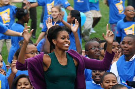 WASHINGTON, DC - OCTOBER 11:  First lady Michelle Obama does jumping jacks with 400 school children on the South Lawn of the White House, on October 11, 2011 in Washington, DC. First lady Michelle Obama led local school children in doing one minute of continuous jumping jacks while attempting to help break the Guinness world record.  (Photo by Mark Wilson/Getty Images)