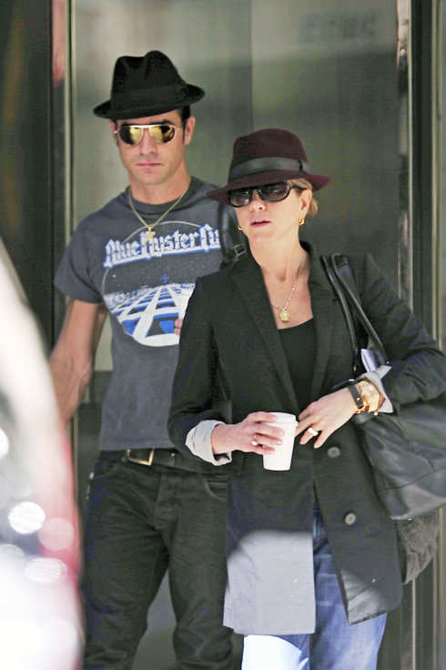 Jennifer Aniston, with her beau Justin Theroux closely behind her, seen exiting an office building in New York City.