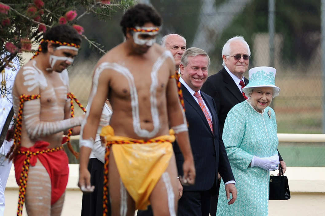 PERTH, AUSTRALIA - OCTOBER 27:  Aboriginal dancers perform for Queen Elizabeth II during her visit to Clontarf Aboriginal college on October 27, 2011 in Perth, Australia. The Queen and Duke of Edinburgh are on a 10-day visit to Australia and will travel to Canberra, Brisbane, and Melbourne before heading to Perth for the Commonwealth Heads of Government meeting. This is the Queen's 16th official visit to Australia. (Photo by William West-Pool/Getty Images)