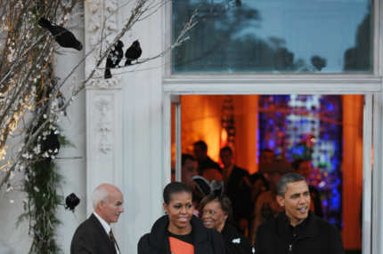 From left: First Lady Michelle Obama , her mother Marian Robinson, and US President Barack Obama make their way to greet trick-or-treaters October 29, 2011 on the North Portico of the White House in Washington, DC. AFP PHOTO/Mandel NGAN (Photo credit should read MANDEL NGAN/AFP/Getty Images)