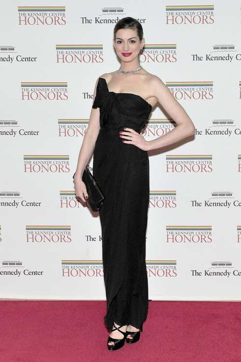 WASHINGTON, DC - DECEMBER 3:  (AFP OUT) Anne Hathaway arrives for the formal Artist's Dinner honoring the recipients of the 2011 Kennedy Center Honors hosted by United States Secretary of State Hillary Rodham Clinton at the U.S. Department of State December 3, 2011 in Washington, DC. President Barack Obama will host the five recipients of the 34th Kennedy Center Honors at a White House reception Sunday before attending the evening gala at the John F. Kennedy Center for the Performing Arts. The 2011 honorees are actress Meryl Streep, singer Neil Diamond, actress Barbara Cook, musician Yo-Yo Ma, and musician Sonny Rollins..(Photo by Ron Sachs-Pool/Getty Images)