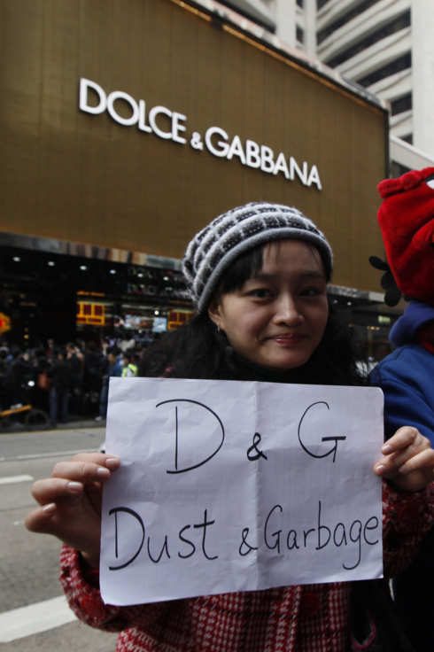 Protesters hold a placard outside a chain store of Dolce & Gabbana in Hong Kong Sunday, Jan. 8, 2012.