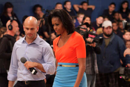 DALLAS, TX - FEBRUARY 10:  First Lady Michelle Obama joins Bravo's 'Top Chef' host Tom Colicchio (L) at Kleberg-Rylie Recreation Center on February 10, 2012 in Dallas, Texas. Six Members of the tv series 'Top Chef' competed with members of the Dallas Cowboys football team in a healthy cooking competition. (Photo by Mike Fuentes/Getty Images)