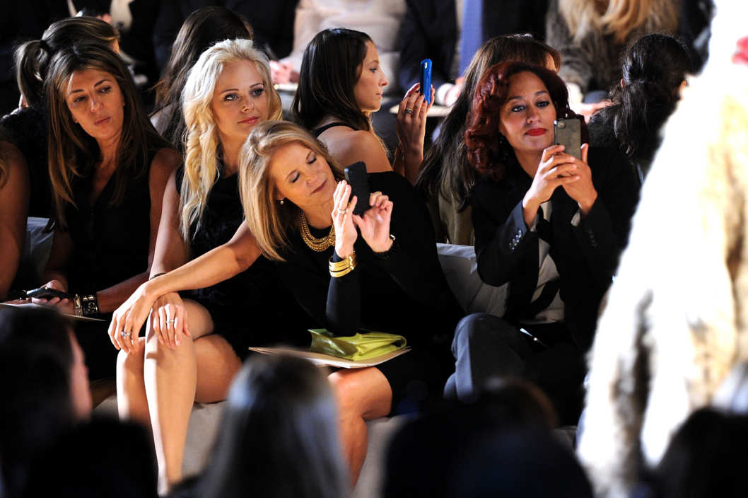 (L-R)  Fashion journalist Nina Garcia, recording artist Heather Schmid, journalist Katie Couric and actress Tracee Ellis Ross attend the Michael Kors Fall 2012 fashion show