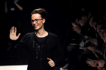 French designer Maxime Simoens acknowledges the crowd at the end of his Spring/Summer 2012 Haute Couture collection show