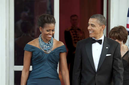 U.S. President Barack Obama, right, and first lady Michelle Obama walk to greet David Cameron, U.K. prime minister, and his wife Samantha Cameron
