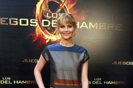 "MADRID, SPAIN - MARCH 26:  Actress  Jennifer Lawrence of ""The Hunger Games"" (Los Juegos del Hambre) attends an event with fans at Capitol cinema on March 26, 2012 in Madrid, Spain.  (Photo by Carlos Alvarez/Getty Images)"