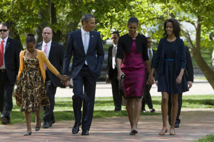 President Barack Obama, First Lady Michelle Obama and daughters Sasha and Malia walk across Lafayette Park to attend Easter Services at St. John's Episcopal Church