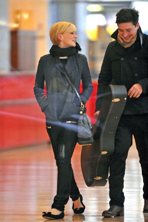 Sunday January 8, 2012. Carey Mulligan and fiance Marcus Mumford, from the band Mumford and Sons, are spotted at the New York Times building in New York City.