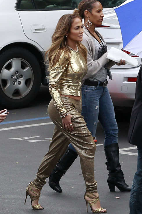 76874, LOS ANGELES, CALIFORNIA - Wednesday April 25, 2012.  Jennifer Lopez films scenes for 'American Idol' in Los Angeles. JLo showed off her figure in a gold outfit. Randy Jackson and Steven Tyler were also on set. Photograph:  Juan Sharma/ Bruja?PacificCoastNews.com**FEE MUST BE AGREED PRIOR TO USAGE** **E-TABLET/IPAD & MOBILE PHONE APP PUBLISHING REQUIRES ADDITIONAL FEES** UK OFFICE:+44 131 557 7760/7761 US OFFICE:1 310 261 9676 (Newscom TagID: pacificphotos720048) [Photo via Newscom]