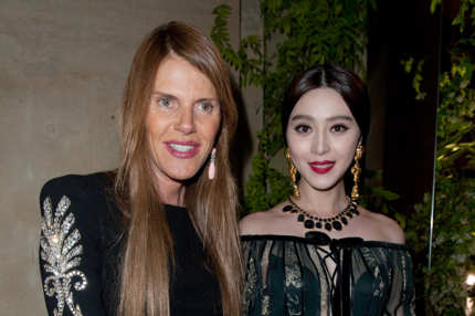 Anna Dello Russo and Fan Bing Bing attend the Salvatore Ferragamo Cruise Collection 2013 show presented at Galerie Denon at the Louvre Museum on June 12, 2012 in Paris, France.