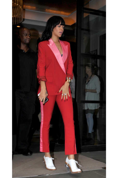Rihanna steps out wearing a red suit, London, UK.