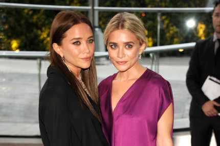 Mary-Kate Olsen and Ashley Olsen attend 2012 CFDA Fashion Awards at Alice Tully Hall on June 4, 2012 in New York City.