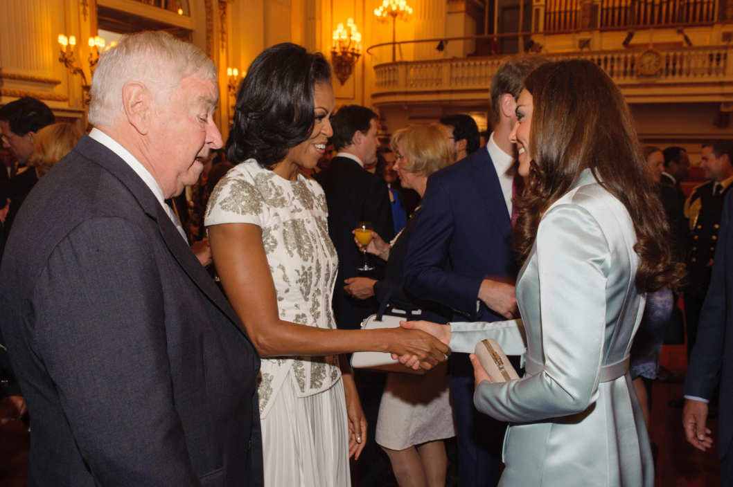 US First Lady Michelle Obama and US Ambassador Louis Susman (L) meets Catherine, Duchess of Cambridge as US Ambassador Louis Susman looks on during a reception at Buckingham Palace a reception for Heads of State and Government attending the Olympics Opening Ceremony  on July 27, 2012 in London, England.