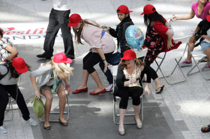 LONDON, UNITED KINGDOM - AUGUST 19: Participants at the 'Trident Unwraps Hundreds of Musical Chairs' contest to win Beyonce concert tickets on August 19, 2009 in London, England. (Photo by Neil Mockford/Getty Images)