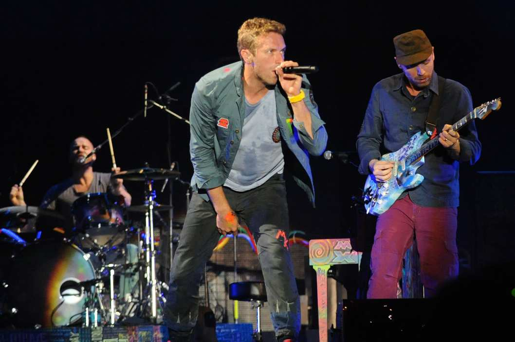 ATLANTA, GA - SEPTEMBER 24:  Will Champion, Chris Martin and Jonny Buckland of Coldplay perform at Piedmont Park on September 24, 2011 in Atlanta, Georgia.  (Photo by Chris McKay/WireImage)