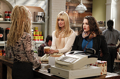 """And the Pretty Problem""  -- Caroline (Beth Behrs, left) enrolls herself and Max (Kat Dennings, right) in a cake-decorating class to increase their skill level and take their cupcake business to the next level, on 2 BROKE GIRLS, Monday, Oct. 31 (8:30-9:00 PM, ET/PT) on the CBS Television Network. Photo: Sonja Flemming/CBS ?2011 CBS Broadcasting Inc. All Rights Reserved."