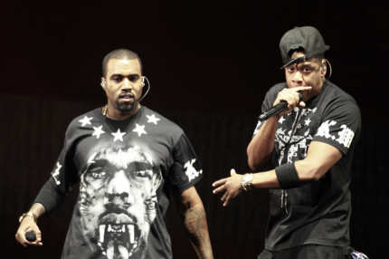 "Kanye West, left, and Jay Z perform in concert during the ""Watch The Throne"" tour, Sunday, Nov. 6, 2011, in East Rutherford, N.J. (AP Photo/Julio Cortez)"