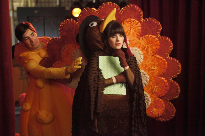 "NEW GIRL:  Jess (Zooey Deschanel, R) and her crush, fellow teacher Paul (guest star Justin Long, L) watch their students perform in the school Thanksgiving festival in the ""Thanksgiving"" episode of NEW GIRL airing Tuesday, Nov. 15 (9:01-9:31 PM ET/PT) on FOX.  ©2011 Fox Broadcasting Co.  Cr:  Greg Gayne/FOX©2011 Fox Broadcasting Co.  Cr:  Greg Gayne/FOX"