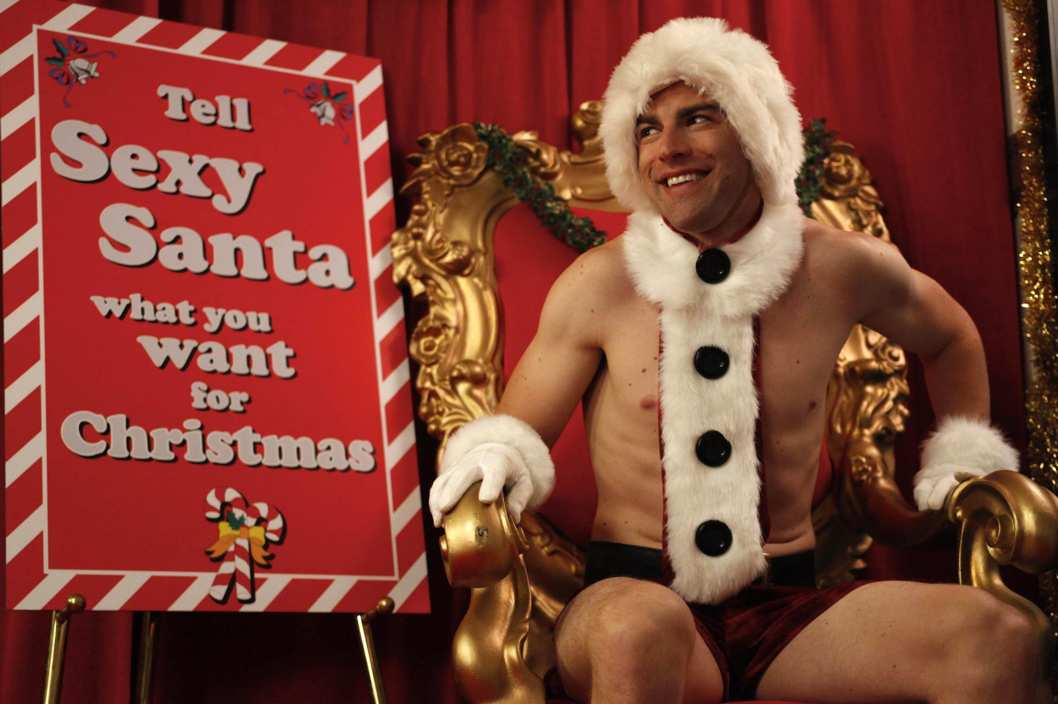 "Schmidt (Max Greenfield) plays ""Sexy Santa"" at his office Christmas party in the""Christmas"" episode of NEW GIRL airing Tuesday, Dec. 13."