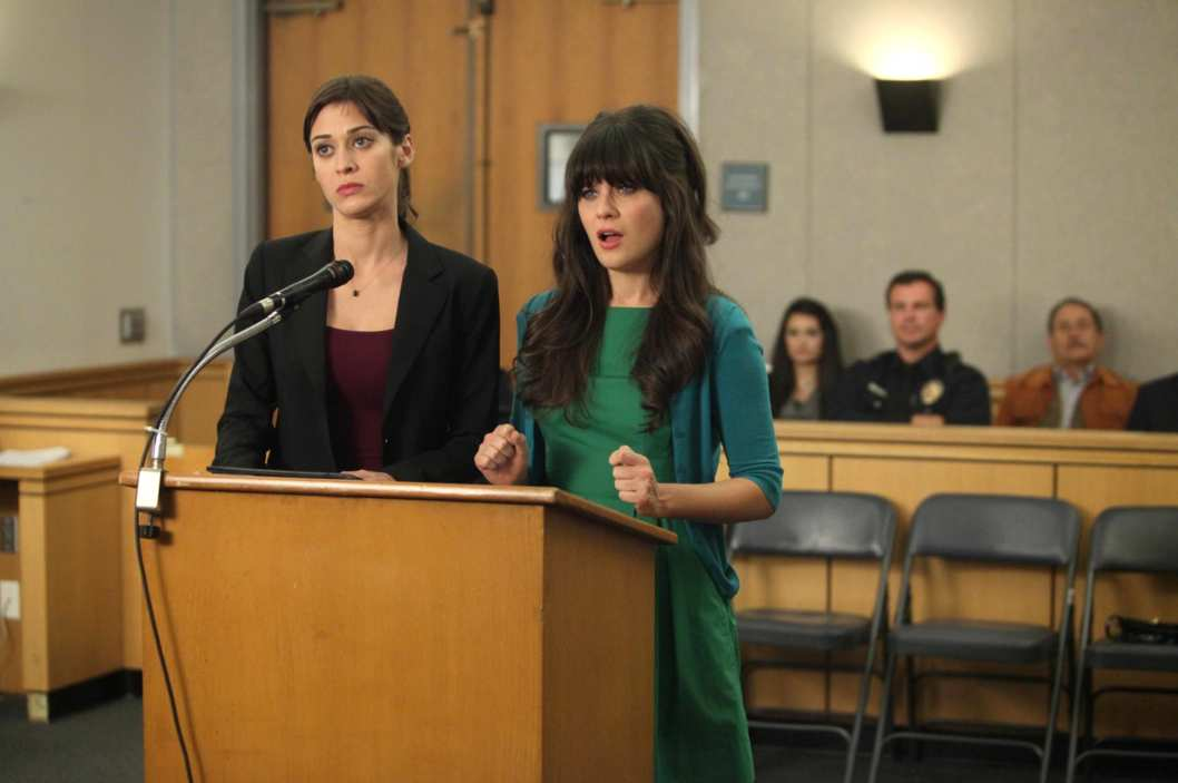 "NEW GIRL:  Nick's girlfriend Julia (guest star Lizzy Caplan, L) helps Jess (Zooey Deschanel, R) fight a traffic ticket in the ""Jess and Julia"" episode of NEW GIRL airing Tuesday, Jan. 31."