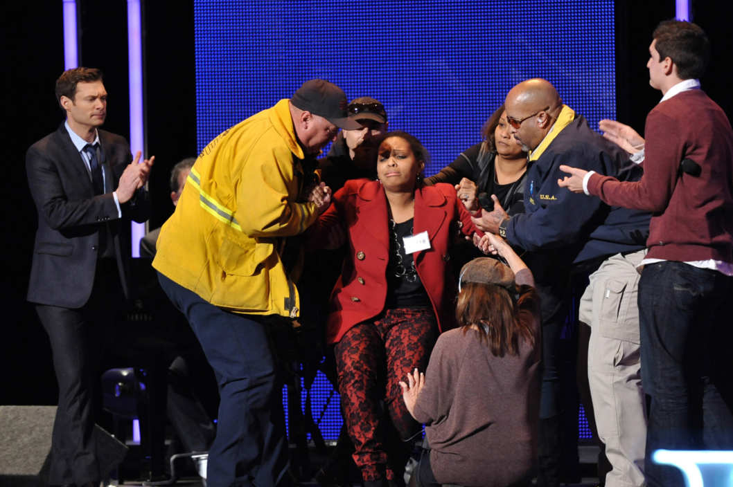 AMERICAN IDOL: Hollywood: Over 300 contestants made it to Hollywood and only 70 will survive. The Hollywood round begins Wednesday, Feb. 8 (8:00-9:00 PM ET/ PT) and Thursday, Feb. 9 (8:00-9:00 PM ET/PT) on FOX. Pictured: A contestant is helped off the stage after fainting during her performance. CR: Michael Becker / FOX.