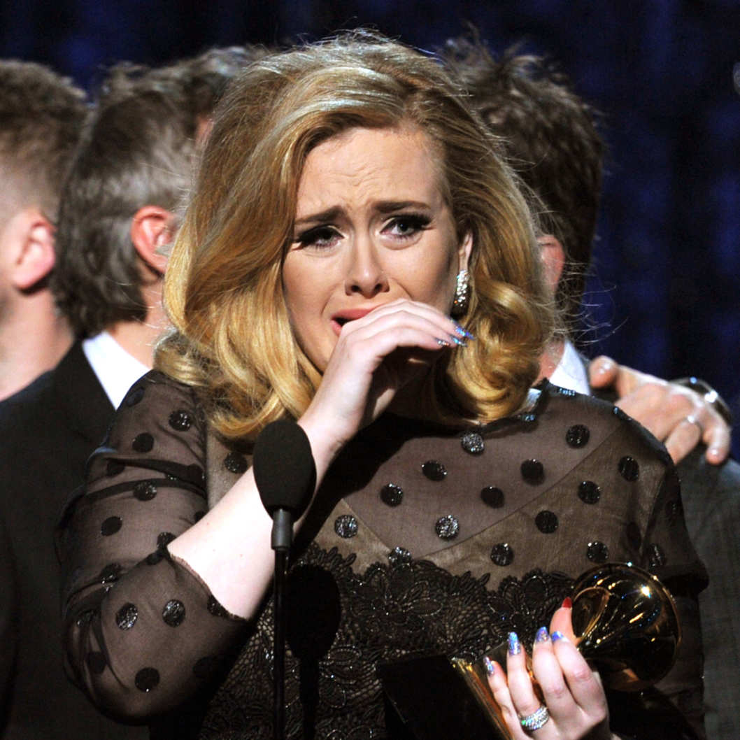 "LOS ANGELES, CA - FEBRUARY 12:  Singer Adele accepts the Album of the Year Award for ""21""onstage at the 54th Annual GRAMMY Awards held at Staples Center on February 12, 2012 in Los Angeles, California.  (Photo by Kevin Winter/Getty Images)"