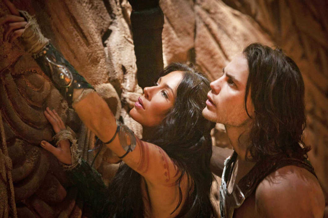 L to R: Dejah Thoris (Lynn Collins) and John Carter (Taylor Kitsch)
