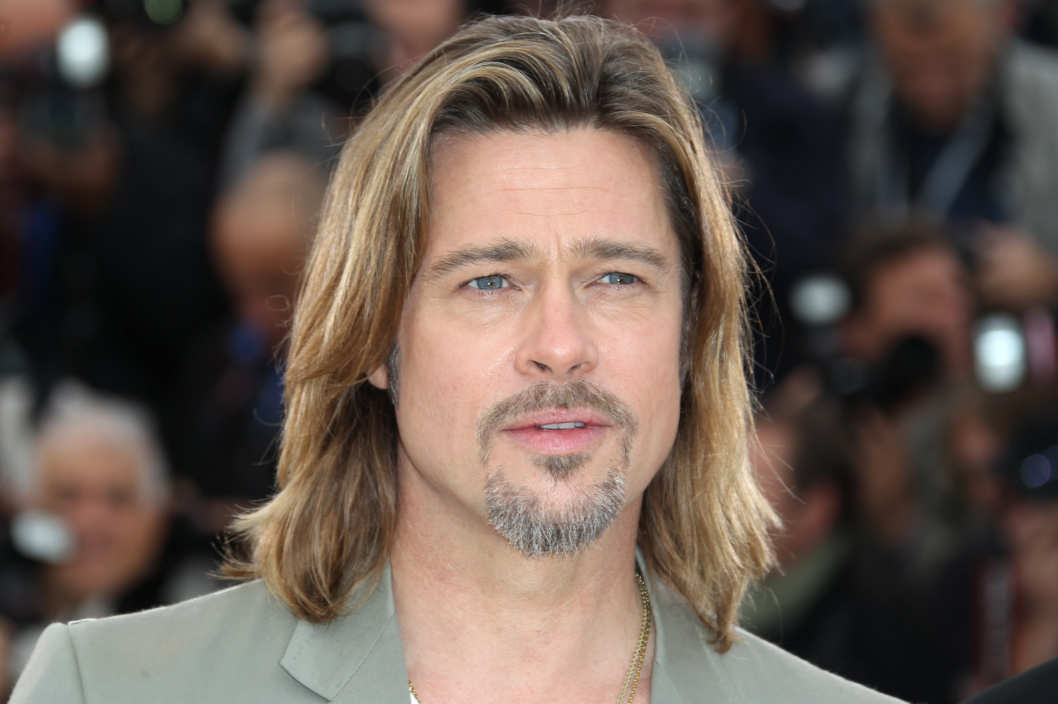 "US actor Brad Pitt poses during the photocall of ""Killing them Softly"" presented in competition at the 65th Cannes film festival on May 22, 2012 in Cannes."