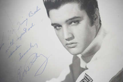 NEW YORK, NY - MARCH 21:  An original photograph of Elvis Presley autographed and inscribed to songwriter and compose Irving Berlin on auction at Gotta Have It! store on March 21, 2012 in New York City.  (Photo by Michael Loccisano/Getty Images)