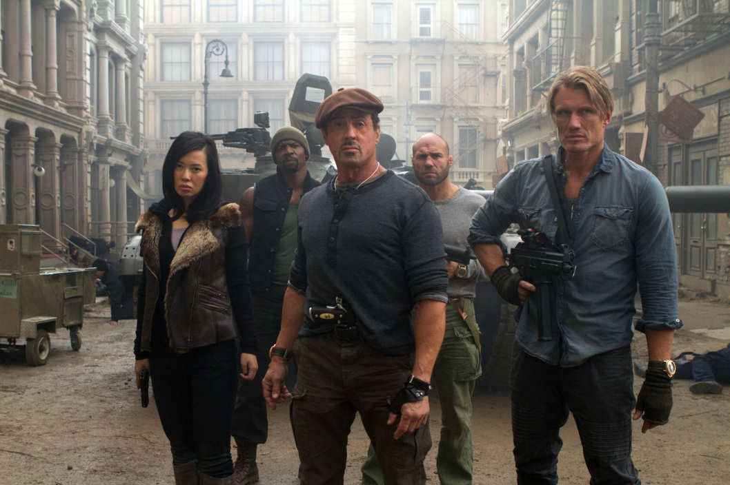 Maggie (Yu Nan, front left), Barney Ross (Sylvester Stallone, front center), Gunner Jensen (Dolph Lundgren, front right), Hale Caesar (Terry Crews, back left) and Toll Road (Randy Couture, back right) in THE EXPENDABLES 2.