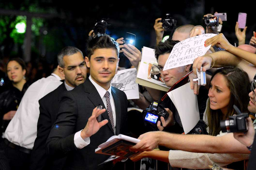 "Zac Efron signs autographs at the ""At Any Price"" premiere during the 2012 Toronto International Film Festival at the Princess of Wales Theatre on September 9, 2012 in Toronto, Canada."