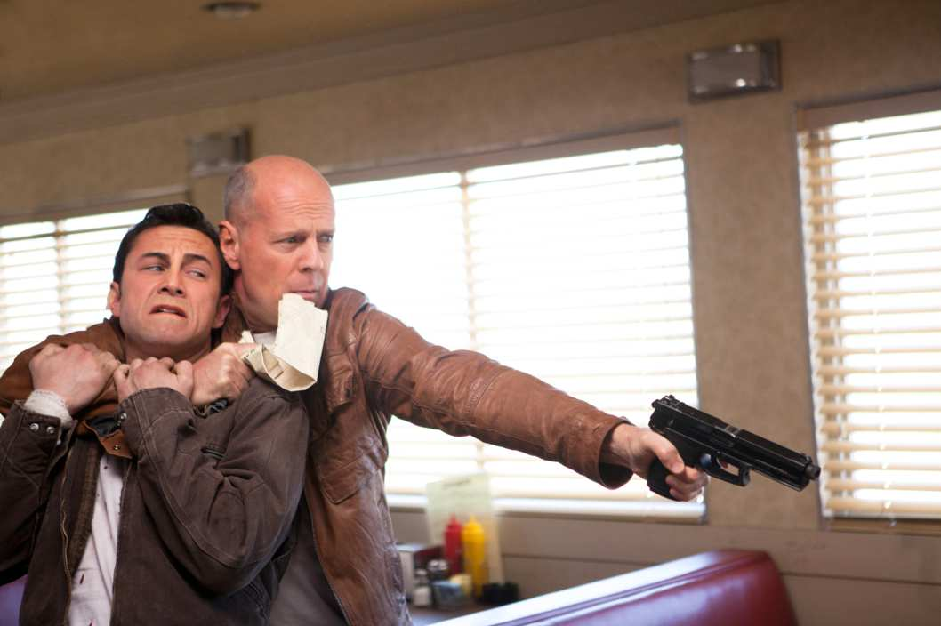 "Joseph Gordon-Levitt and Bruce Willis as ""Joe"" in TriStar Pictures, Film District, and End Game Entertainment's action thriller LOOPER."