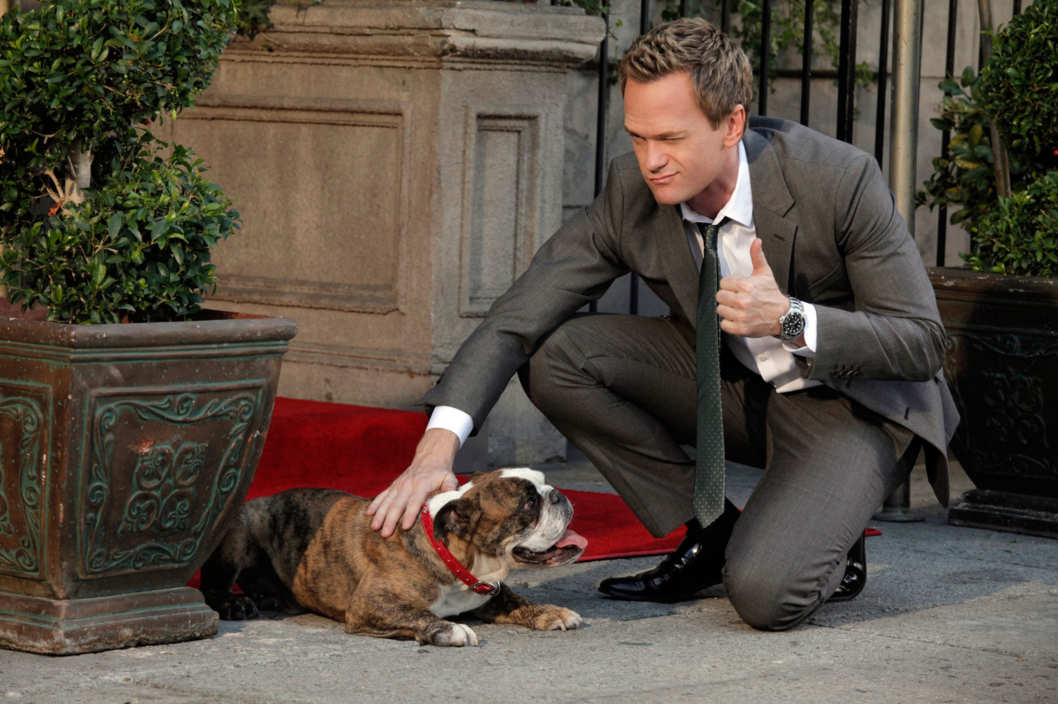 """œThe Autumn of Break-Ups"" -- Barney Stinson (Neil Patrick Harris) distracts the bulldog (Ernie) while his wingman ""œBrover"" hits on a yorkie mix, on HOW I MET YOUR MOTHER, Monday, Oct. 29 (8:00-8:30 PM, ET/PT) on the CBS Television Network."