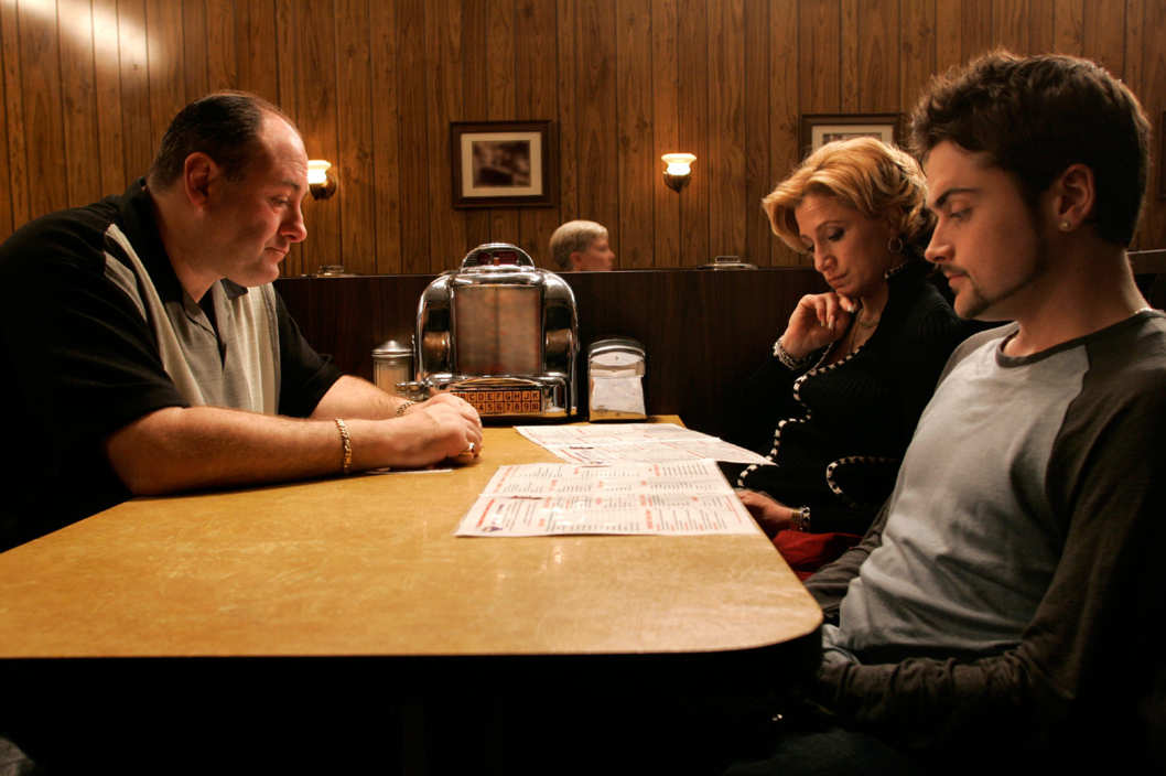 "The Sopranos  ""Made In America"" - ""The gang shows up for family dinner"" - James Gandolfini (Tony Soprano) - Edie Falco (Carmela) - Robert Iler (Anthony Jr.)"