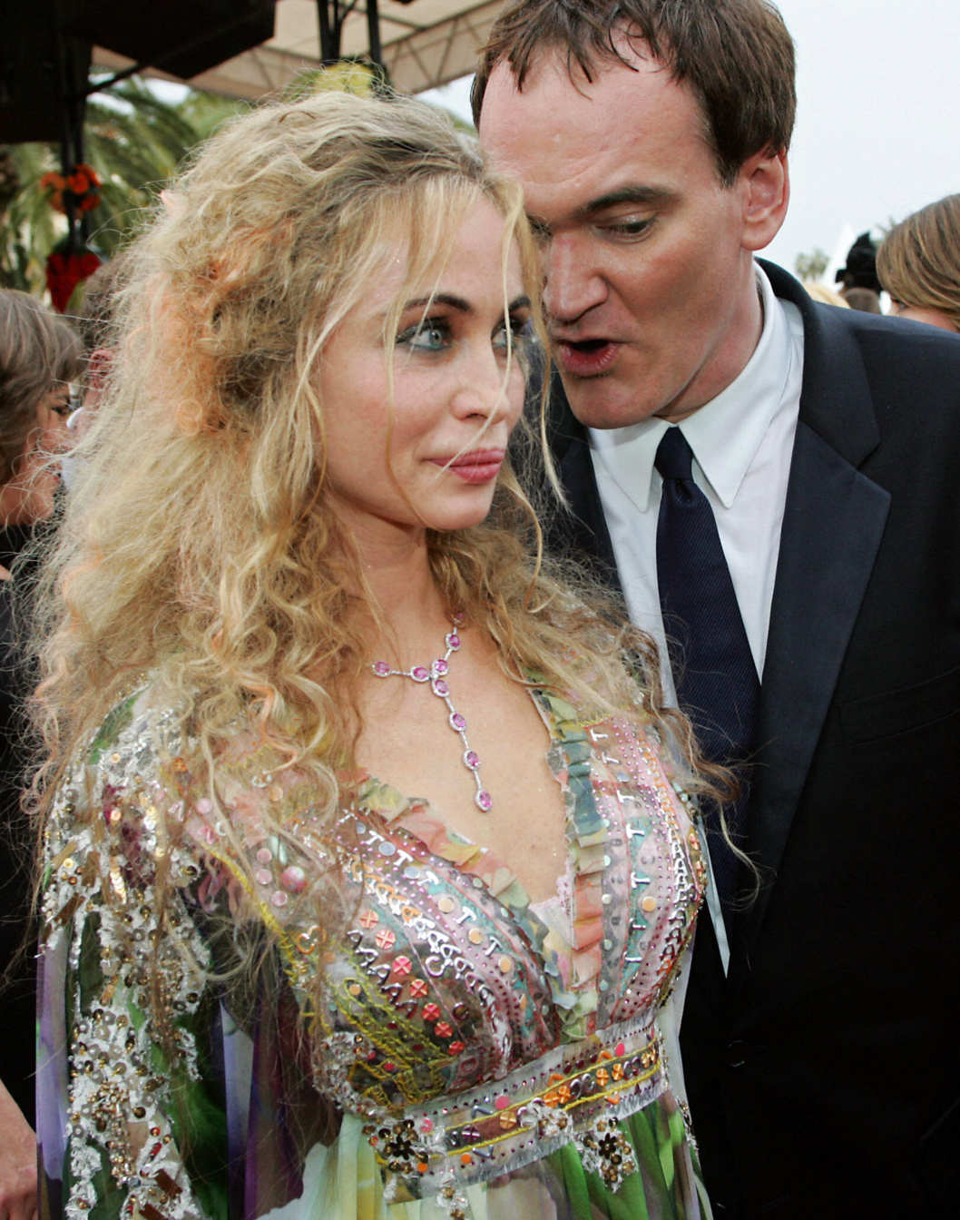 CANNES, France:  French actress Emmanuelle Beart and US director Quentin Tarantino arrive to attend the opening ceremony at the 57th Cannes International Film Festival, 12 May 2004, in the French Riveria town of Cannes. The world's top film festival opened for its annual 12-day swirl of projections, parties and publicity after finessing a last-minute deal with protesting French entertainment industry workers to stop them sabotaging the event. AFP PHOTO FRANCOIS GUILLOT  (Photo credit should read FRANCOIS GUILLOT/AFP/Getty Images)
