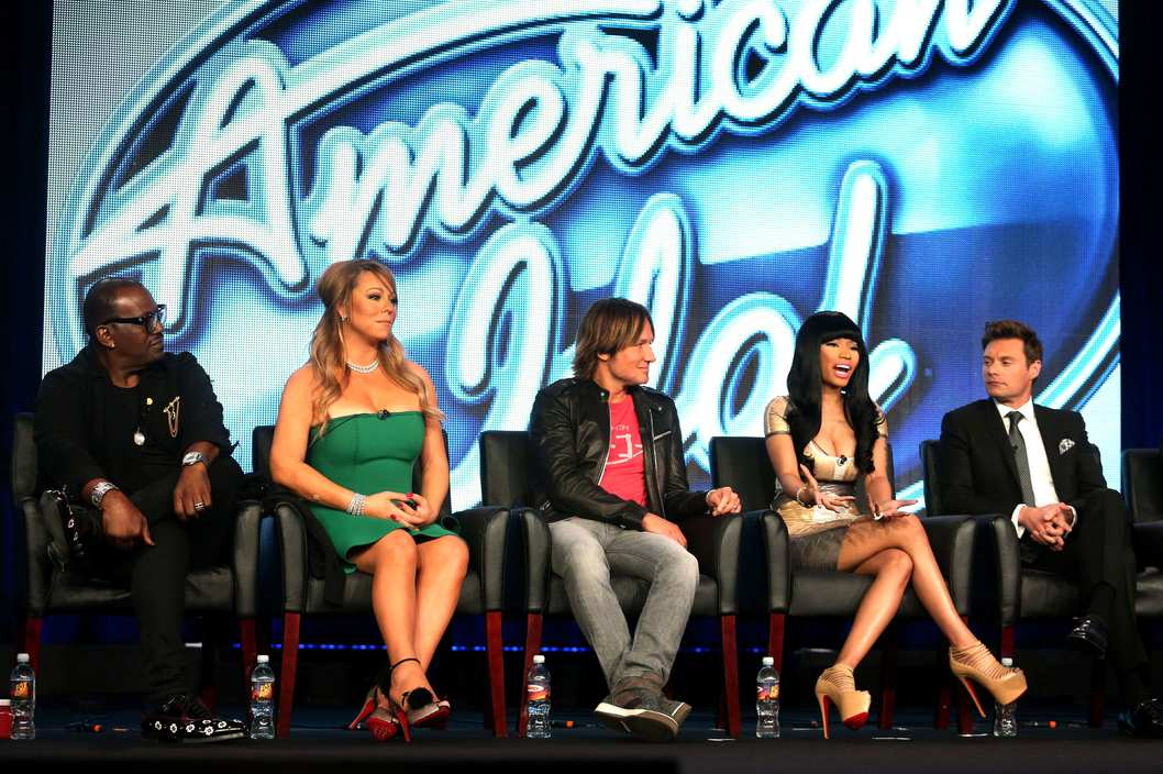 "(L-R) Judges Randy Jackson, Mariah Carey, Keith Urban, Nicki Minaj and host Ryan Seacrest of ""American Idol"" speak onstage during the FOX portion of the 2013 Winter TCA Tour at Langham Hotel on January 8, 2013 in Pasadena, California."