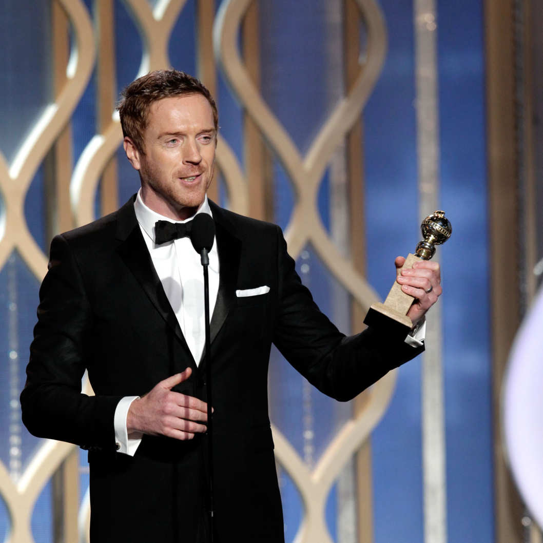 "In this handout photo provided by NBCUniversal, Actor Damian Lewis accepts the best actor award for TV Series, Drama, ""Homeland"" on stage during the 70th Annual Golden Globe Awards at the Beverly Hilton Hotel International Ballroom on January 13, 2013 in Beverly Hills, California."