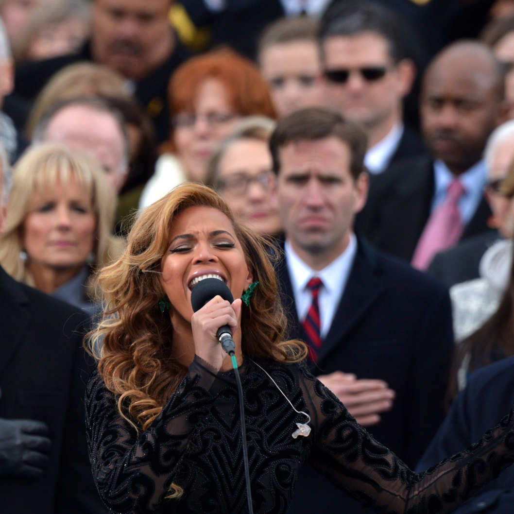 Beyonce performs the National Anthem as Vice-President Joe Biden, his wife Dr. Jill Biden (2nd L), his son Beau Biden (C background), former President Bill Clinton (far L) and wife, US Secretary of State Hillary Clinton (C-background), and US Justice Anthony Kennedy (R) listen during the 57th Presidential Inauguration ceremonial swearing-in at the US Capitol on January 21, 2013 in Washington, DC.