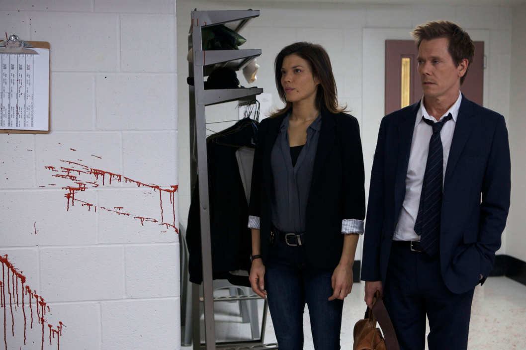 THE FOLLOWING: Former FBI agent Ryan Hardy (Kevin Bacon, R) is brought in to help solve a crime in the new drama THE FOLLOWING premiering Jan. 21 (9:00-10:00 PM ET/PT) on FOX.