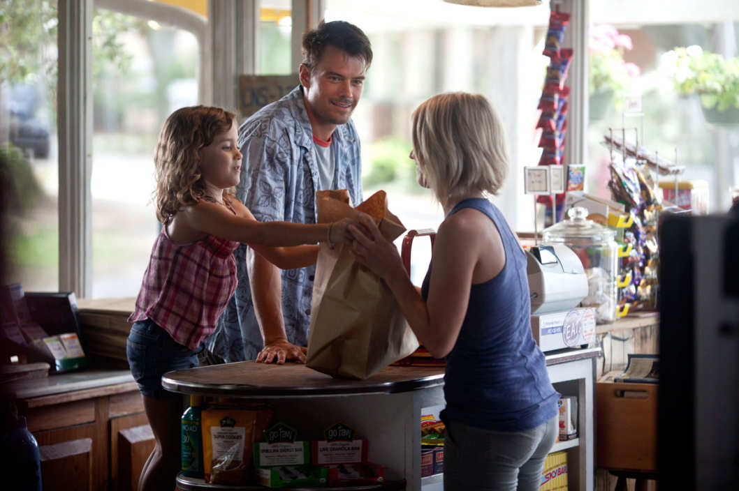 "(Left to right.) Mimi Kirkland, Josh Duhamel and Julianne Hough star in Relativity Media's ""Safe Haven."""