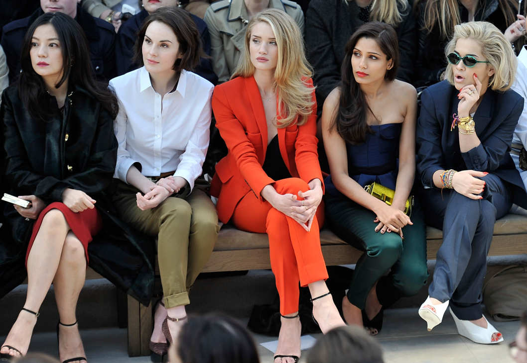 LONDON, ENGLAND - FEBRUARY 18:  (L-R) Vicki Zhao, Michelle Dockery, Rosie Huntington-Whiteley, Freida Pinto and Rita Ora sit in the front row for the Burberry Prorsum Autumn Winter 2013 Womenswear show on February 18, 2013 in London, England.  (Photo by Gareth Cattermole/Getty Images for Burberry)